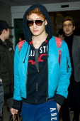 Zhoumi of boy band Super Junior M is seen upon arrival at Incheon International Airport on February 25 2013 in Incheon South Korea