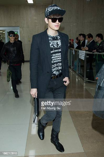 Zhoumi of boy band Super Junior M is seen upon arrival at the Gimpo Airport on October 28 2013 in Seoul South Korea
