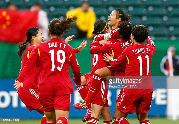 Zhu Beiyan of China PR celebrates after scoring on a penalty kick past goalkeeper Meike Kaemper of Germany at Commonwealth Stadium on August 8 2014...