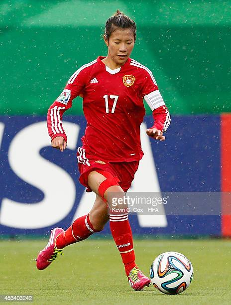 Zhu Beiyan of China PR in action during the FIFA U20 Women's World Cup Canada 2014 match between China PR and Germany at Commonwealth Stadium on...