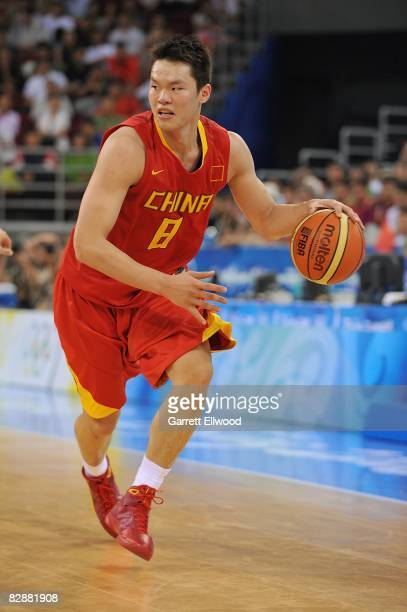Zhu Fangyu of China drives the ball up court against Lithuania during the 2008 Beijing Summer Olympics on August 20 2008 at the Beijing Olympic...