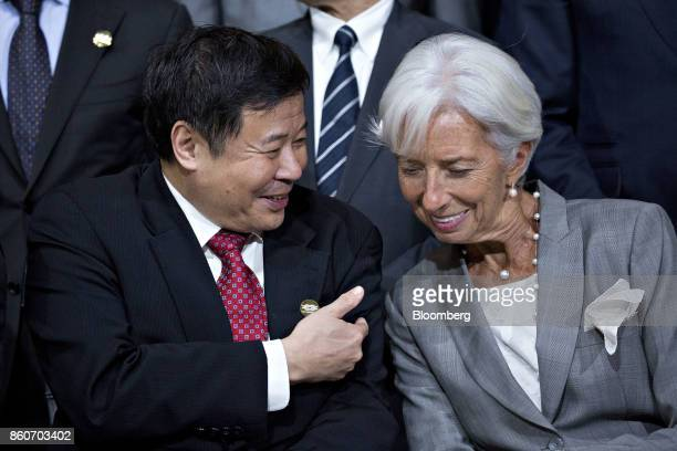 Zhu Guangyao China's vice minister of finance left talks to Christine Lagarde managing director of the International Monetary Fund during a Group of...