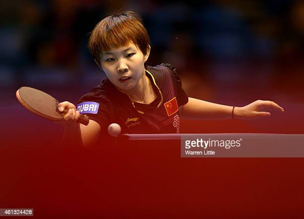 Zhu Yuling of China in action against Myong Sun Ri of North Korea during the Women's Final of the 2015 ITTF World Team Cup at Al Nasr Sports Stadium...