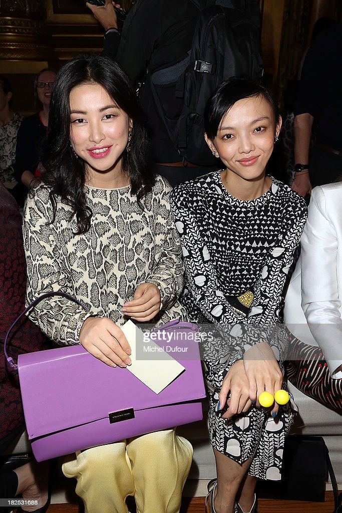 <a gi-track='captionPersonalityLinkClicked' href=/galleries/search?phrase=Zhu+Zhu&family=editorial&specificpeople=4421471 ng-click='$event.stopPropagation()'>Zhu Zhu</a> and <a gi-track='captionPersonalityLinkClicked' href=/galleries/search?phrase=Rila+Fukushima&family=editorial&specificpeople=10133717 ng-click='$event.stopPropagation()'>Rila Fukushima</a> attend the Stella McCartney show as part of the Paris Fashion Week Womenswear Spring/Summer 2014 on September 30, 2013 in Paris, France.