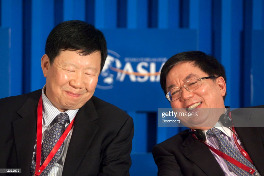 Zhuang Xinyi, vice chairman of the China Securities Regulatory Commission (CSRC), left, and Li Jiange, chairman of China International Capital Corp., attend a session at the Boao Forum for Asia in Boao, Hainan Province, China, on Tuesday, April 3, 2012. The Boao Forum ends today. Photographer: Nelson Ching/Bloomberg via Getty Images