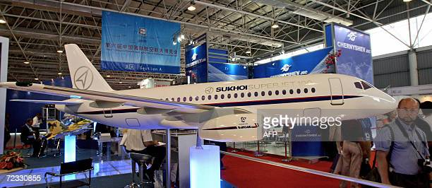 Visitors look at a model of Russia's Sukhoi superjet at the 6th China International Aviation and Aerospace Exhibition in Zhuhai 01 November 2006...