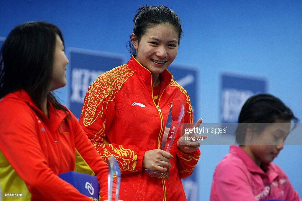 Zi He (C) of China celebrates during the award ceremony after winning the Women's 3m Springboard Diving Final on Day 2 of the 2013 China Diving Champions Cup at Jinan Olympic Sports Center on January 24, 2013 in Jinan, China.
