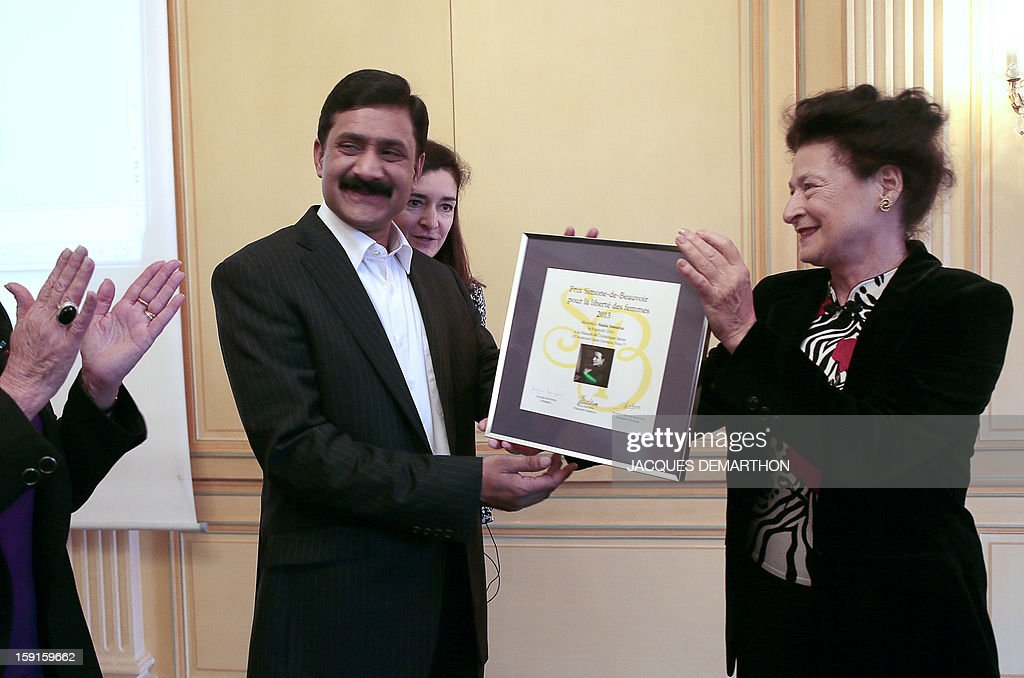 Ziauddin Yousafzai (L), the father of Malala Yousafzai, the young Pakistani schoolgirl activist who was the victim of an assasination attempt by the Taliban in 2012, receives the 2013 Simone de Beauvoir award from the hands of Sylvie Le Bon de Beauvoir (R) during the awards ceremony in Paris on January 9, 2013. The 2013 Simone de Beauvoir prize for the freedom of women was handed to Malala Yousafzai, who has become a symbol of the struggle for girls' education and women's rights in Pakistan. Malala was flown to the United Kingdom with a life-threatening head wound shortly after her attack but recovered from her injuries and was temporarily discharged on January 4 as she awaits more surgery.