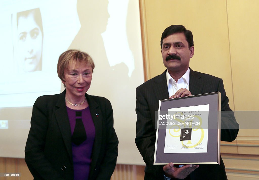 Ziauddin Yousafzai (R), the father of Malala Yousafzai, the young Pakistani schoolgirl activist who was the victim of an assasination attempt by the Taliban in 2012, stands alongside writer Julia Kristeva (L) after being handed the 2013 Simone de Beauvoir award for Malala, in Paris on January 9, 2013. The 2013 Simone de Beauvoir prize for the freedom of women was handed to Malala Yousafzai, who has become a symbol of the struggle for girls' education and women's rights in Pakistan. Malala was flown to the United Kingdom with a life-threatening head wound shortly after her attack but recovered from her injuries and was temporarily discharged on January 4 as she awaits more surgery.
