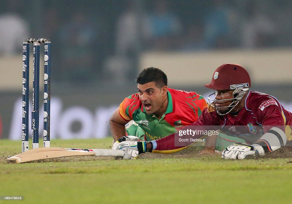 Ziaur Rahman (L) of Bangladesh reacts after missing the stumps as he attempts to run out <a gi-track='captionPersonalityLinkClicked' href=/galleries/search?phrase=Marlon+Samuels&family=editorial&specificpeople=185235 ng-click='$event.stopPropagation()'>Marlon Samuels</a> of the West Indies during the ICC World Twenty20 Bangladesh 2014 match between Bangladesh and the West Indies at Sher-e-Bangla Mirpur Stadium on March 25, 2014 in Dhaka, Bangladesh.