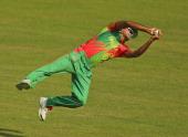 Ziaur Rahman of Bangladesh takes a diving catch to dismiss Kamran Akmal of Pakistan during the ICC World Twenty20 Bangladesh 2014 match between...
