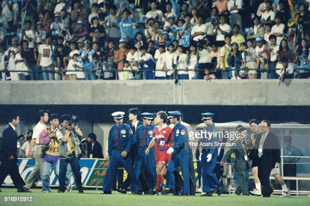 Zico of Kashima Antlers is surrounded by security staffs as he farewells fans after the JLeague match between Jubilo Iwata and Kashima Antlers at...