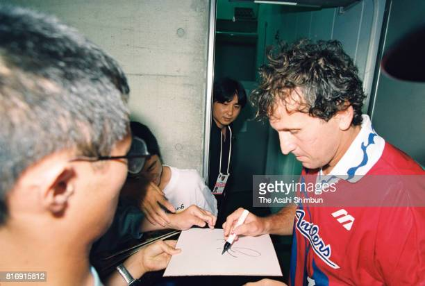 Zico of Kashima Antlers signs autographs for fans after the JLeague match between Jubilo Iwata and Kashima Antlers at Jubilo Iwata Soccer Stadium on...