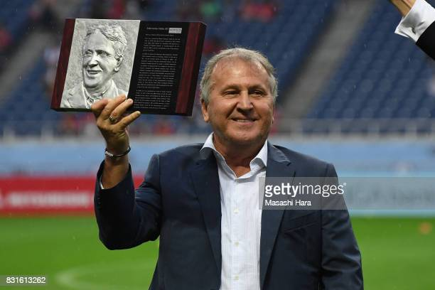 Zico poses with the plaque of the Japan Football Hall of Fame during the Award Ceremony prior to the Suruga Bank Championship match between Urawa Red...