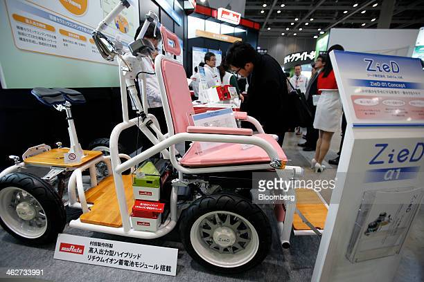 A ZieD Co ZieD a1 Concept electric vehicle equipped with Murata Manufacturing Co hybrid lithiumion storage cell modules sits on display while a...