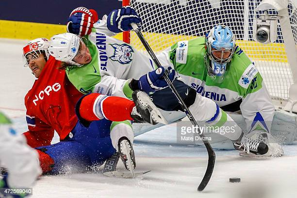 Ziga Jeglic of Slovenia and Andreas Martinsen of Norway battle for the puck in front of Robert Kristan goalkeeper of Slovenia during the IIHF World...
