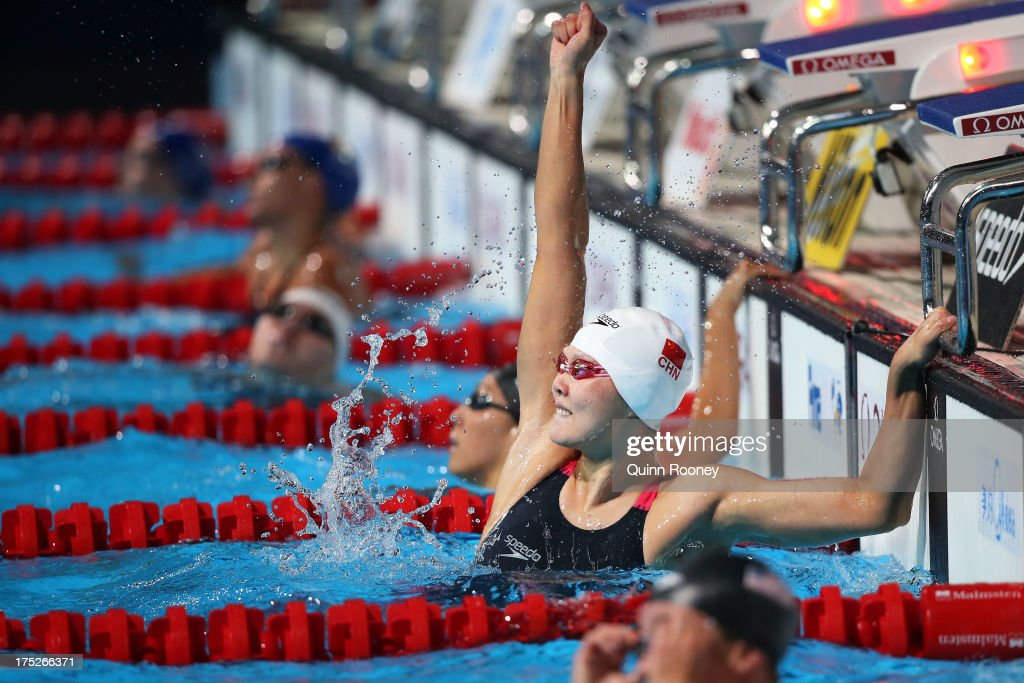 Zige Liu of China celebrates after winning the Swimming Women's Butterfly 200m Final on day thirteen of the 15th FINA World Championships at Palau Sant Jordi on August 1, 2013 in Barcelona, Spain.