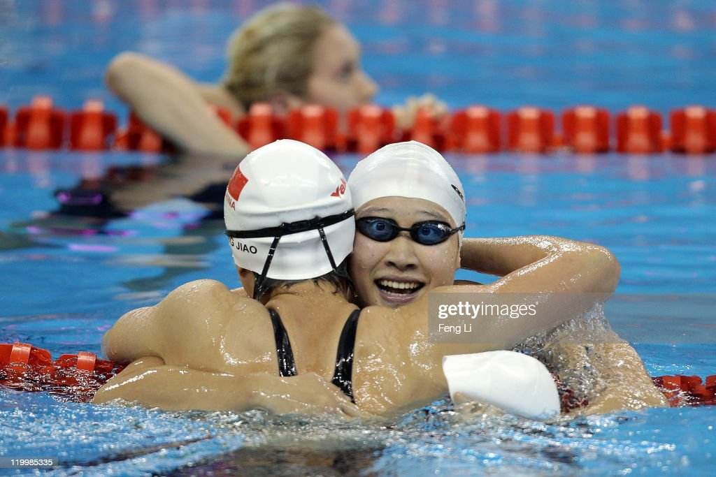 Zige Liu (R) of China congratulates gold medalist Liuyang Jiao of China after she won the Women's 200m Butterfly Final during Day Thirteen of the 14th FINA World Championships at the Oriental Sports Center on July 28, 2011 in Shanghai, China.