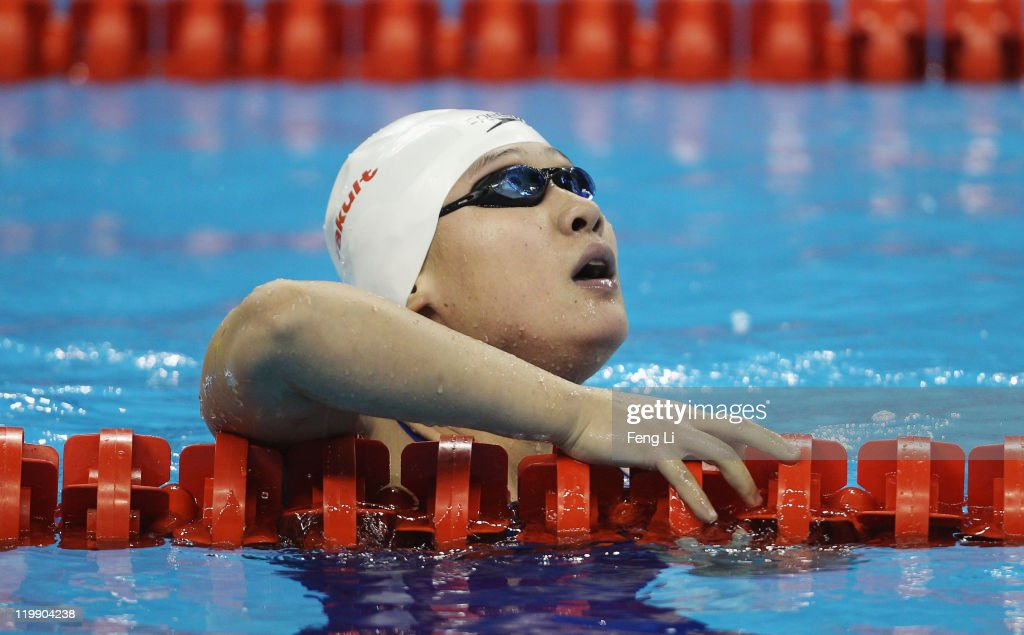 Zige Liu of China looks on after she swam in heat five of the Women's 200m Butterfly heats during Day Twelve of the 14th FINA World Championships at the Oriental Sports Center on July 27, 2011 in Shanghai, China. on July 27, 2011 in Shanghai, China.