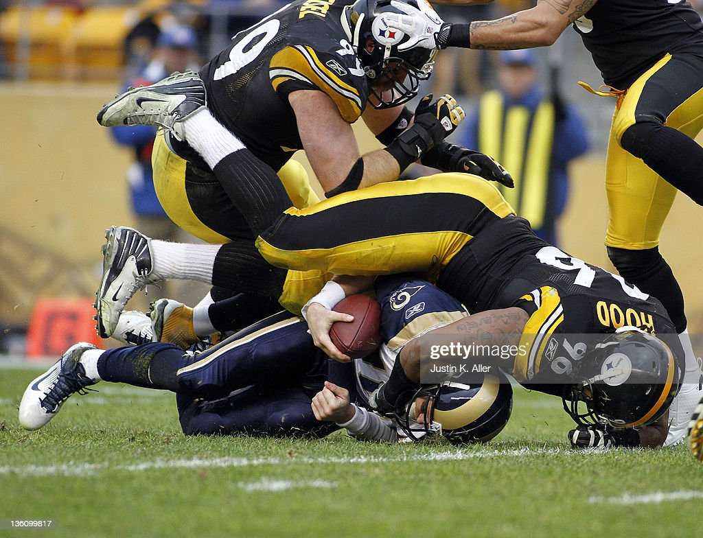 Ziggy Hood #96 of the Pittsburgh Steelers tackles Kellen Clemens #10 of the St. Louis Rams during the game on December 24, 2011 at Heinz Field in Pittsburgh, Pennsylvania. The Steelers won 27-0.
