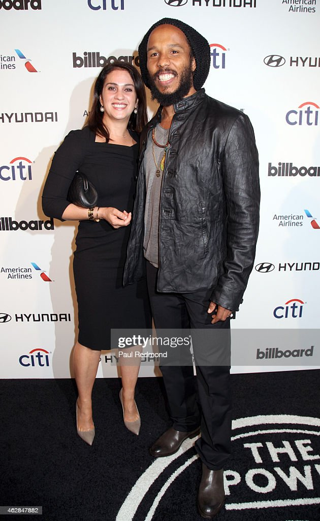 Ziggy Marley and a guest attend the 2015 Billboard Power 100 Celebration at Bouchon on February 5 2015 in Beverly Hills California