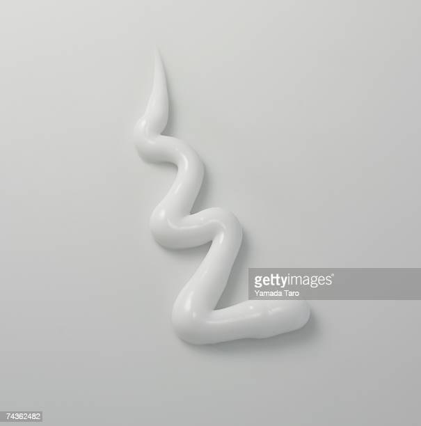 Zigzag shape of white cream, close-up