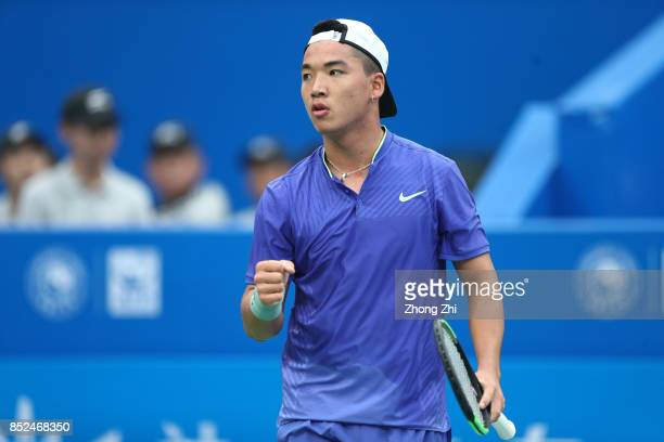 Zihao Xia of China celebrates a point during the match against Michael Venus of New Zealand during Qualifying first round of 2017 ATP Chengdu Open at...