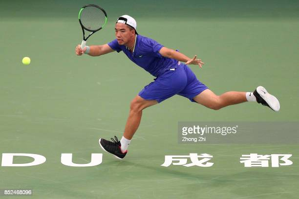 Zihao Xia of China returns a shot during the match against Michael Venus of New Zealand during Qualifying first round of 2017 ATP Chengdu Open at...