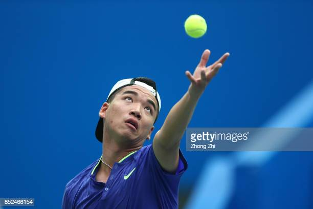 Zihao Xia of China serves during the match against Michael Venus of New Zealand during Qualifying first round of 2017 ATP Chengdu Open at Sichuan...