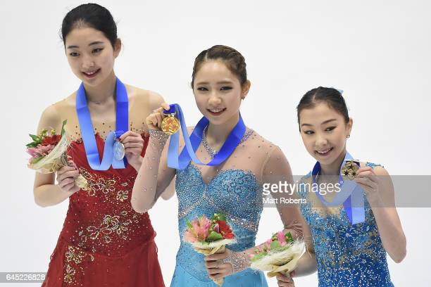Zijun Li of China Dabin Choi of Korea and Elizabet Tursynbaeva of Kazakhstan pose on the podium after the women's figure skating on the day eight of...