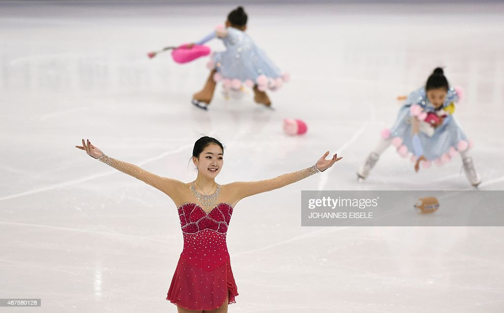 Zijun Li (L) of China reacts after her ladies short program of the 2015 ISU World Figure Skating Championships at Shanghai Oriental Sports Center in Shanghai on March 26, 2015.