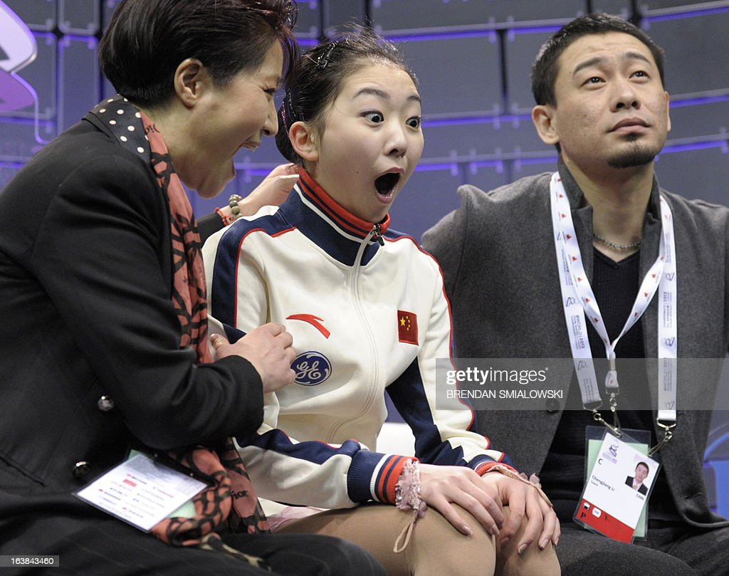 Zijun Li, representing China, reacts to her scores in the free program women's competition at the 2013 World Figure Skating Championships in London, Ontario, March 16, 2013. AFP PHOTO/Brendan SMIALOWSKI