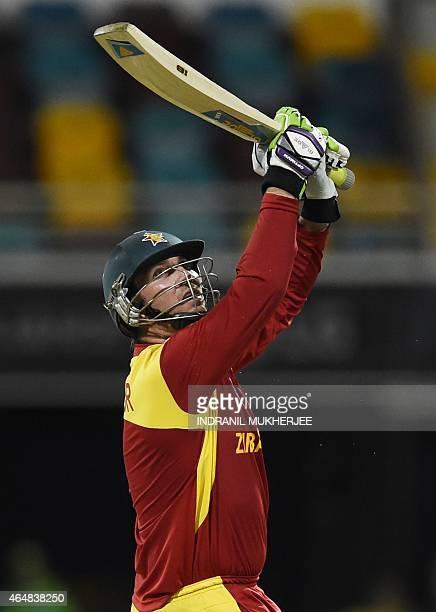 Zimbabwe batsman Brendan Taylor plays a shot during the 2015 Cricket World Cup Pool B match between Pakistan and Zimbabwe at the Gabba Stadium in...
