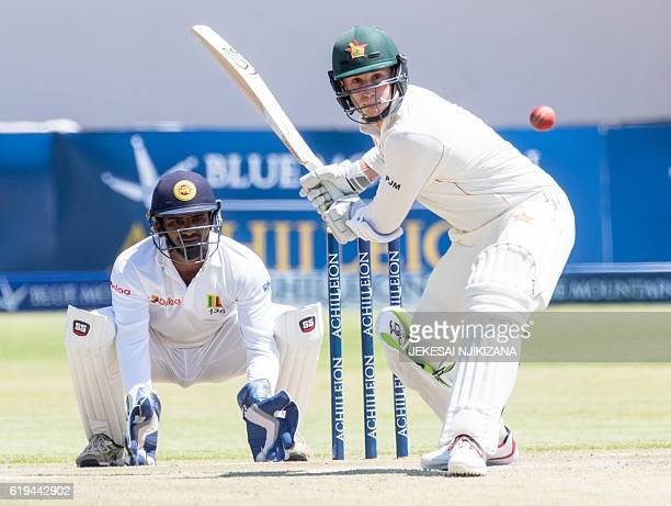 Zimbabwe batsman Peter Moor plays a shot as Sri Lanka wicketkeeper Kusal Janith Perera looks on during the third day's play in the first cricket Test...