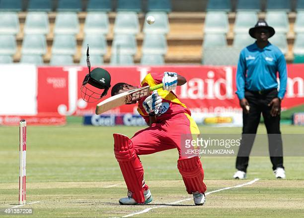 Zimbabwe batsman Richmond Mutumbami is hit by the ball in the head during the final game in a series of three ODI cricket matches between Pakistan...