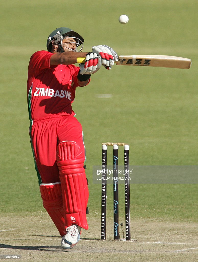 Zimbabwe batsman Sikandar Raza in action during the 1st of the two match T20 cricket series between Zimbabwe and Bangladesh on May 11, 2013 at the Queens Sports Club in Bulawayo, Zimbabwe. AFP PHOTO/Jekesai Njikizana.