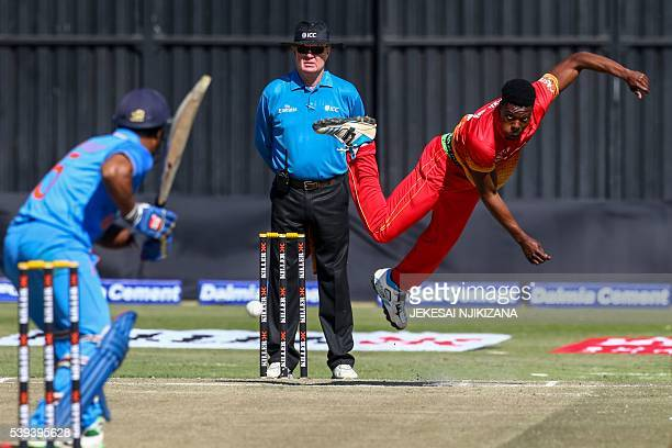 Zimbabwe bowler Taurai Muzarabani throws the ball during the first cricket match between India and hosts Zimbabwe in a series of 3 ODI games at...