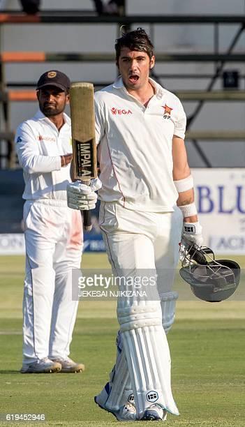 Zimbabwe captain Graeme Cremer celebrates scoring a century during the third day of the first Cricket Test match between Sri Lanka and hosts Zimbabwe...
