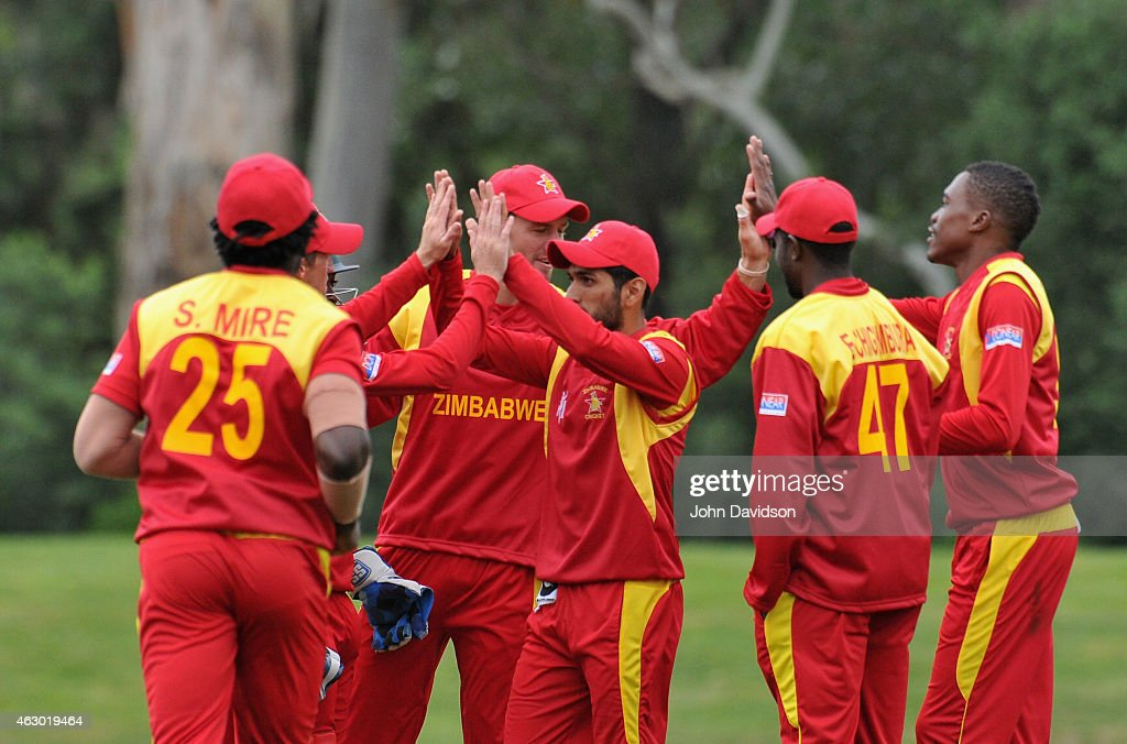 Zimbabwe celebrate the wicket of Tom Latham wicket during the ICC Cricket World Cup warm up match between New Zealand and Zimbabwe at Lincoln Oval on...