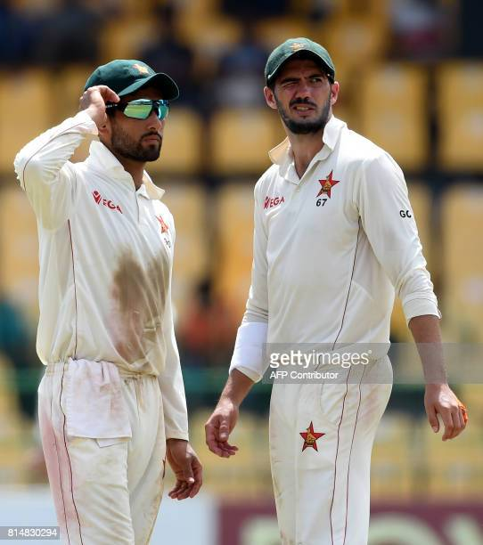 Zimbabwe cricket captain Graeme Cremer and Sikandar Raza look on during the second day of the only oneoff Test match between Sri Lanka and Zimbabwe...
