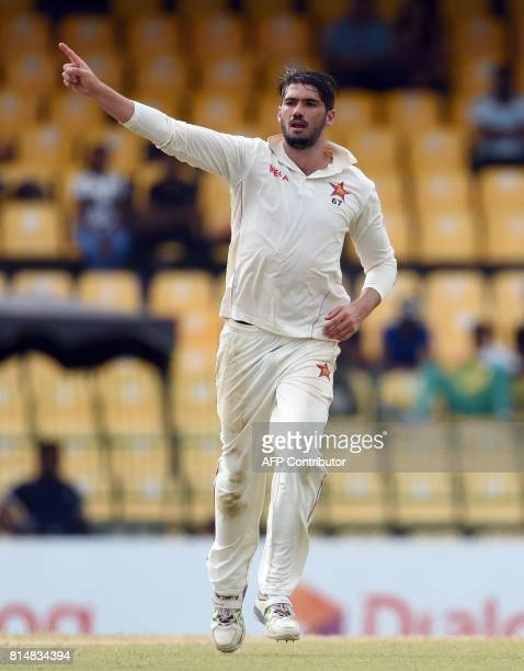Zimbabwe cricket captain Graeme Cremer celebrates after he dismissed Sri Lankan cricket captain Dinesh Chandimal during the second day of the only...