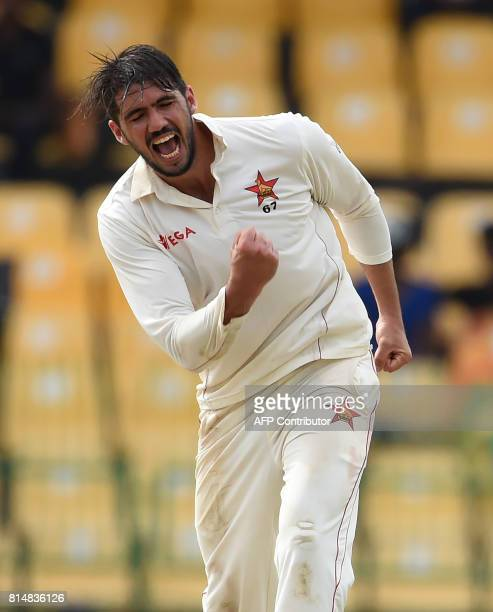 Zimbabwe cricket captain Graeme Cremer celebrates after he dismissed Sri Lankan cricketer Niroshan Dickwella during the Second day of the only oneoff...