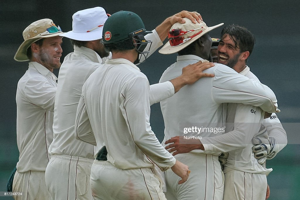 Zimbabwe cricket captain Graeme Cremer(R) celebrates with his team members after dismissing Sri Lankan cricket captain Dinesh Chandimal (unseen) during the 4th day's play in the only Test match between Sri Lanka and Zimbabwe at R Premadasa International Cricket Stadium in the capital city of Colombo, Sri Lanka on Monday 17th July 2017