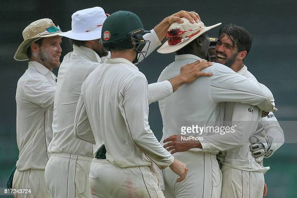 Zimbabwe cricket captain Graeme Cremer celebrates with his team members after dismissing Sri Lankan cricket captain Dinesh Chandimal during the 4th...