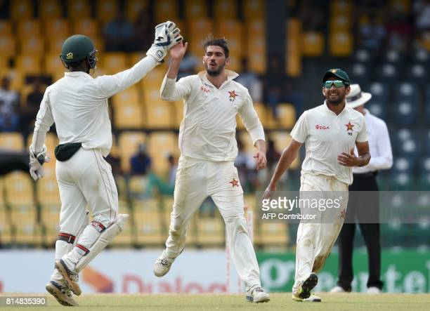Zimbabwe cricket captain Graeme Cremer celebrates with his teammates after he dismissed Sri Lankan cricket captain Dinesh Chandimal during the second...
