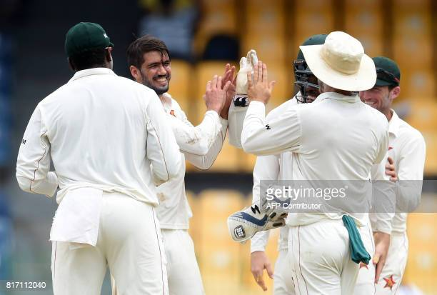 Zimbabwe cricket captain Graeme Cremer celebrates with teammates after dismissing Sri Lankan cricketer Angelo Mathews during the final day of a...