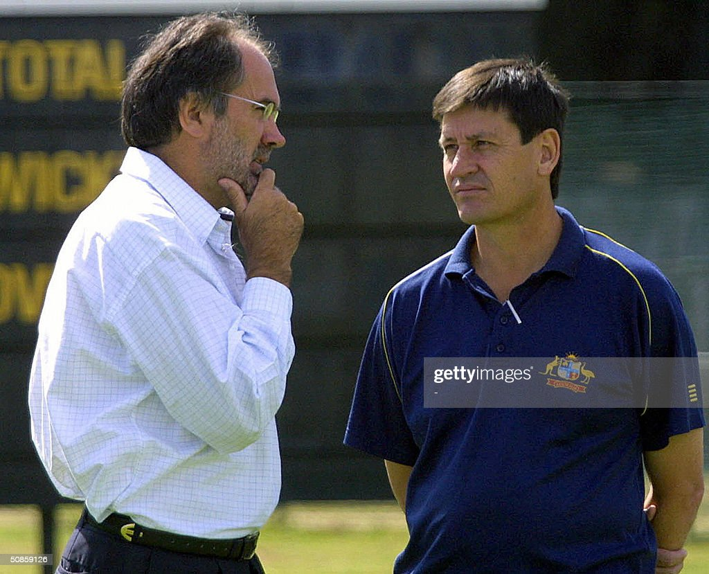Zimbabwe cricket team manager, Vince Hogg (L), talks with Australian team manager Steve Bernard 20 May 2004 at the Harare Sports Club. The 22 May 2004 match between Zimbabwe and Australia is now uncetain due to a dispute between the Zimbabwe Cricket Union and some Zimbabwe players.