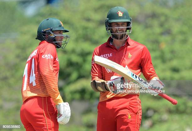 Zimbabwe cricketer Craig Ervine asks for a review is watched teammate Sean Williams during the third oneday international cricket match between Sri...