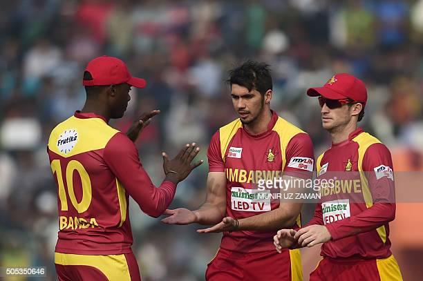 Zimbabwe cricketer Graeme Cremer celebrates with teamamtes after the dismissal of Bangladesh cricketer Soumya Sarkar during the second T20 cricket...