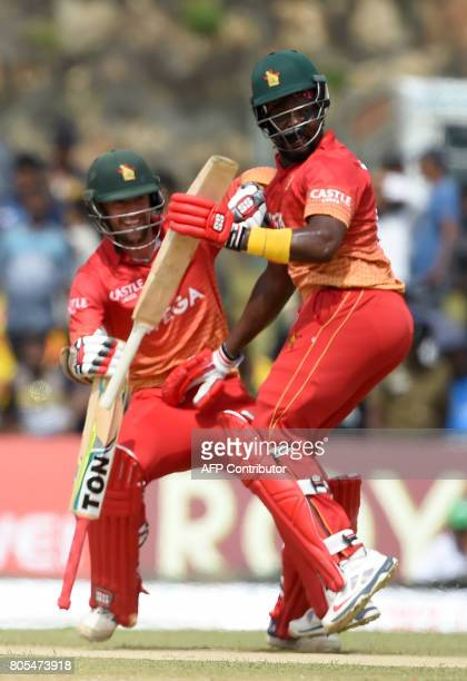 Zimbabwe cricketer Hamilton Masakadza and Craig Ervine run between the wickets plays a shot during the second oneday internationals cricket match...